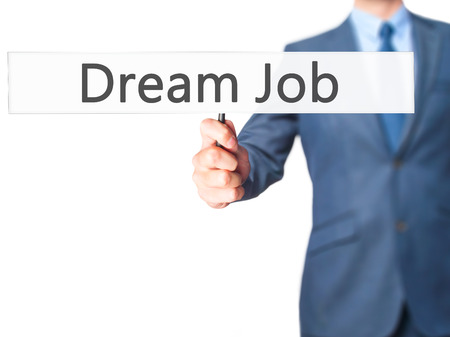 luxacion: Dream Job - Businessman hand holding sign. Business, technology, internet concept. Stock Photo