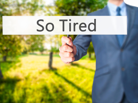 So Tired - Businessman hand holding sign. Business, technology, internet concept. Stock Photo Stock Photo
