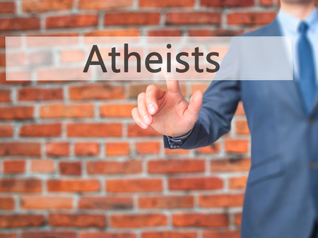 heathen: Atheists - Businessman hand pressing button on touch screen interface. Business, technology, internet concept. Stock Photo