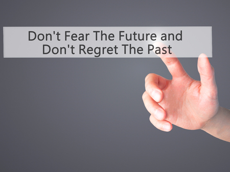 regret: Dont Fear The Future and Dont Regret The Past - Hand pressing a button on blurred background concept . Business, technology, internet concept. Stock Photo Stock Photo