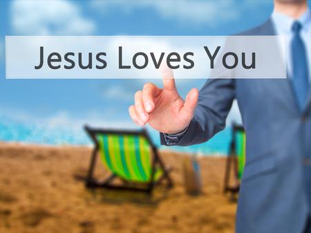 testament schreiben: Jesus Loves You - Businessman hand pressing button on touch screen interface. Business, technology, internet concept. Stock Photo