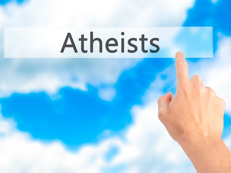 atheism: Atheists - Hand pressing a button on blurred background concept . Business, technology, internet concept. Stock Photo Stock Photo