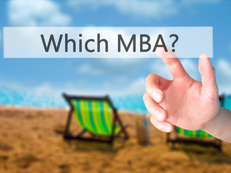 Which MBA? - Hand pressing a button on blurred background concept . Business, technology, internet concept. Stock Photo