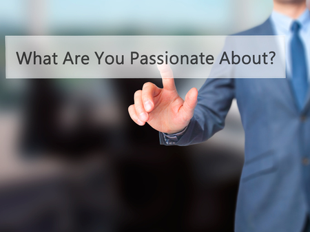 freedom of thought: What Are You Passionate About? - Businessman hand pressing button on touch screen interface. Business, technology, internet concept. Stock Photo