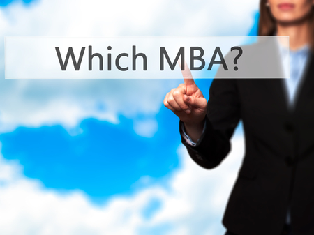 administrativo: Which MBA? - Businesswoman hand pressing button on touch screen interface. Business, technology, internet concept. Stock Photo