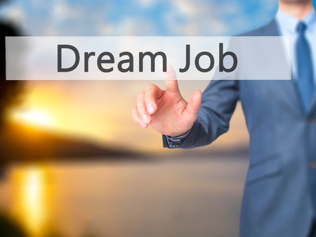 dislocation: Dream Job - Businessman hand pressing button on touch screen interface. Business, technology, internet concept. Stock Photo Stock Photo