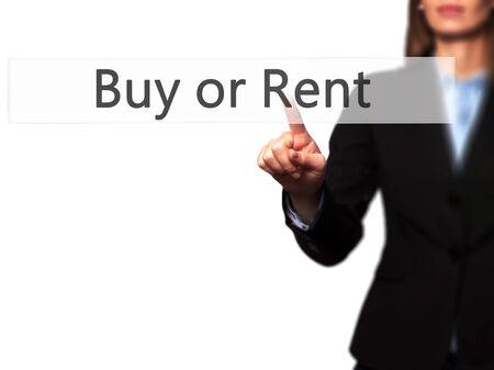 buying questions: Buy or Rent - Isolated female hand touching or pointing to button. Business and future technology concept. Stock Photo Stock Photo