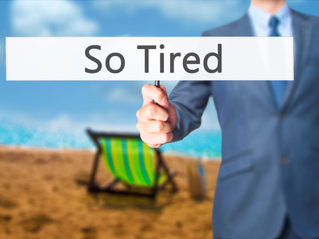 tiredness: So Tired - Businessman hand holding sign. Business, technology, internet concept. Stock Photo Stock Photo