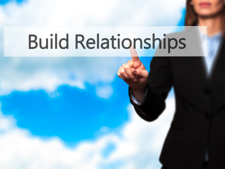 middleman: Build Relationships - Businesswoman hand pressing button on touch screen interface. Business, technology, internet concept. Stock Photo