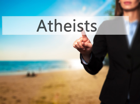 Atheists - Businesswoman hand pressing button on touch screen interface. Business, technology, internet concept. Stock Photo