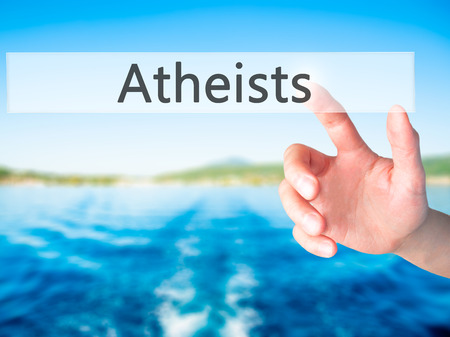 disbelieve: Atheists - Hand pressing a button on blurred background concept . Business, technology, internet concept. Stock Photo Stock Photo