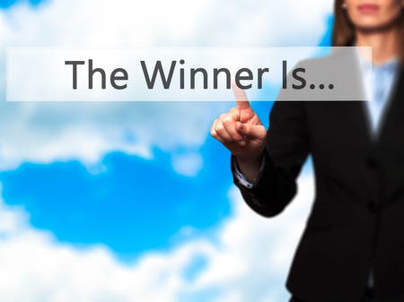 medalist: The Winner Is... - Businesswoman hand pressing button on touch screen interface. Business, technology, internet concept. Stock Photo
