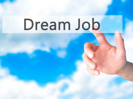 luxacion: Dream Job - Hand pressing a button on blurred background concept . Business, technology, internet concept. Stock Photo Foto de archivo