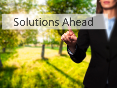 Solutions Ahead - Businesswoman hand pressing button on touch screen interface. Business, technology, internet concept. Stock Photo Stock Photo