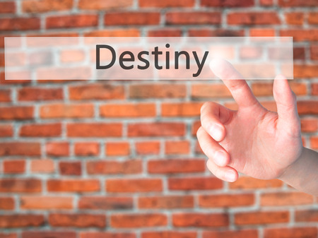 Destiny - Hand pressing a button on blurred background concept . Business, technology, internet concept. Stock Photo Stock Photo