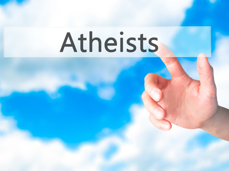nonbelief: Atheists - Hand pressing a button on blurred background concept . Business, technology, internet concept. Stock Photo Stock Photo