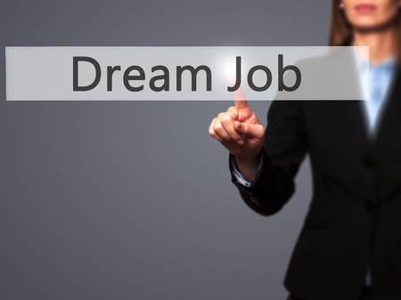 luxacion: Dream Job - Businesswoman hand pressing button on touch screen interface. Business, technology, internet concept. Stock Photo Foto de archivo