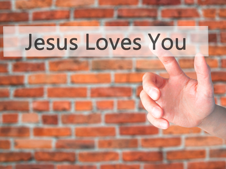 testament schreiben: Jesus Loves You - Hand pressing a button on blurred background concept . Business, technology, internet concept. Stock Photo