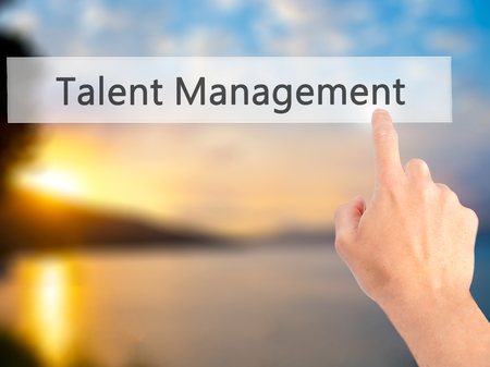 talent management: Talent Management - Hand pressing a button on blurred background concept . Business, technology, internet concept. Stock Photo