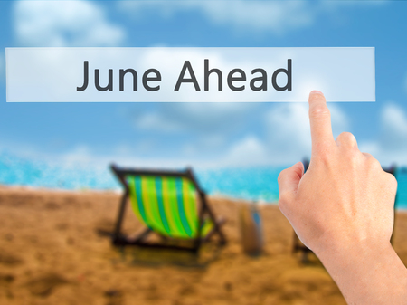 June Ahead - Hand pressing a button on blurred background concept . Business, technology, internet concept. Stock Photo Stock Photo