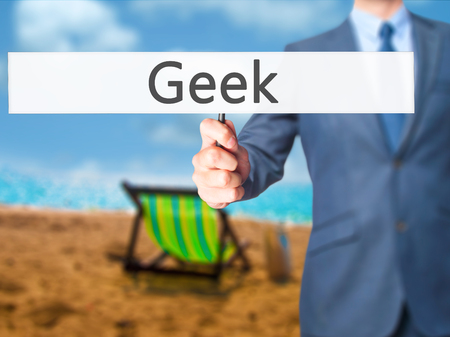 Geek - Businessman hand holding sign. Business, technology, internet concept. Stock Photo