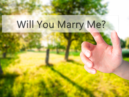 Will You Marry Me ? - Hand pressing a button on blurred background concept . Business, technology, internet concept. Stock Photo