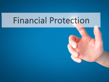 secret society: Financial Protection - Hand pressing a button on blurred background concept . Business, technology, internet concept. Stock Photo
