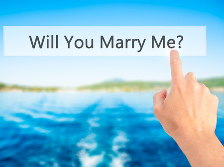 will you marry me: Will You Marry Me ? - Hand pressing a button on blurred background concept . Business, technology, internet concept. Stock Photo
