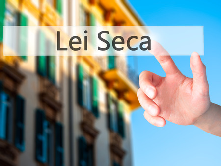 Lei Seca (Prohibition Alcohol Law n Portuguese) - Hand pressing a button on blurred background concept . Business, technology, internet concept. Stock Photo Stock Photo
