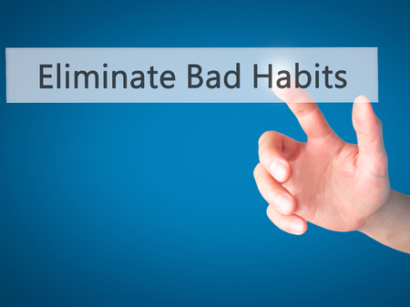 eliminating: Eliminate Bad Habits - Hand pressing a button on blurred background concept . Business, technology, internet concept. Stock Photo