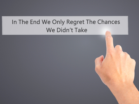 regret: In The End We Only Regret The Chances We Didnt Take - Hand pressing a button on blurred background concept . Business, technology, internet concept. Stock Photo