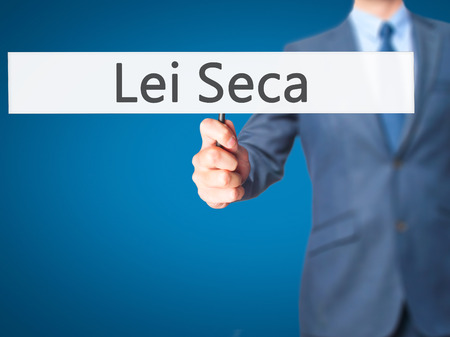 drunk test: Lei Seca (Prohibition Alcohol Law n Portuguese) - Businessman hand holding sign. Business, technology, internet concept. Stock Photo Stock Photo