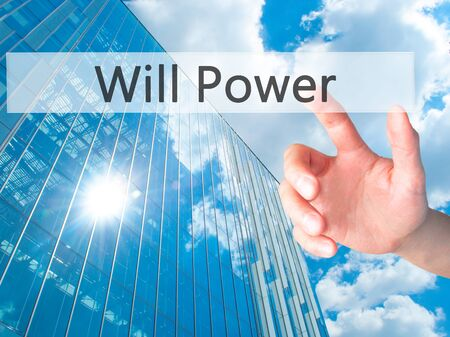 will power: Will Power - Hand pressing a button on blurred background concept . Business, technology, internet concept. Stock Photo