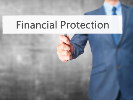 financial protection: Financial Protection - Businessman hand holding sign. Business, technology, internet concept. Stock Photo