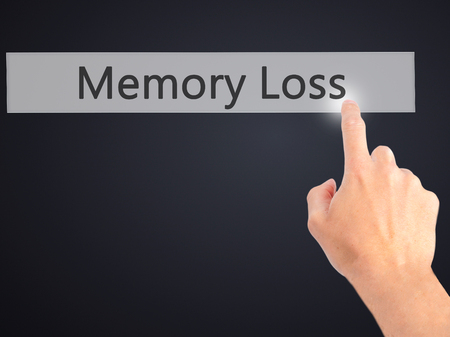 senile: Memory Loss - Hand pressing a button on blurred background concept . Business, technology, internet concept. Stock Photo Stock Photo
