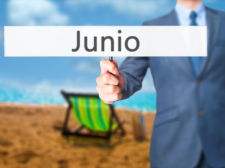 Junio (June in Spanish) - Businessman hand holding sign. Business, technology, internet concept. Stock Photo Stock Photo
