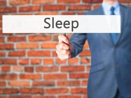 Sleep - Businessman hand holding sign. Business, technology, internet concept. Stock Photo