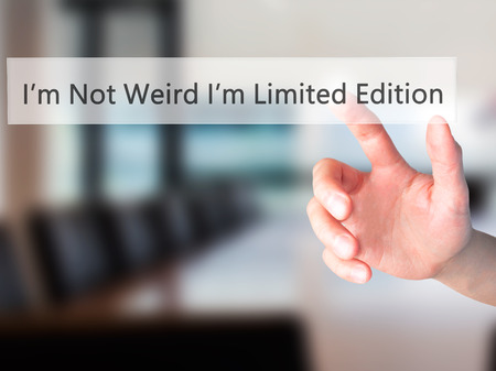 weird: Im Not Weird Im Limited Edition - Hand pressing a button on blurred background concept . Business, technology, internet concept. Stock Photo Stock Photo