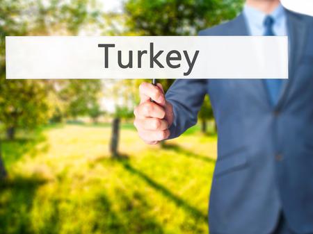 Turkey - Businessman hand holding sign. Business, technology, internet concept. Stock Photo