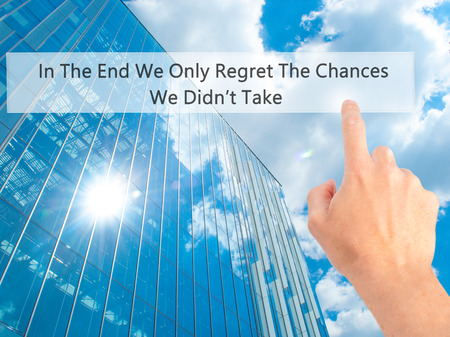 no mistake: In The End We Only Regret The Chances We Didnt Take - Hand pressing a button on blurred background concept . Business, technology, internet concept. Stock Photo