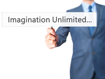 unlimited: Imagination Unlimited... - Businessman hand holding sign. Business, technology, internet concept. Stock Photo