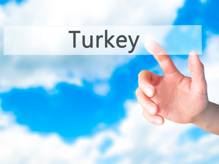 Turkey - Hand pressing a button on blurred background concept . Business, technology, internet concept. Stock Photo Stock Photo