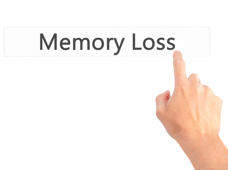 aging brain: Memory Loss - Hand pressing a button on blurred background concept . Business, technology, internet concept. Stock Photo Stock Photo