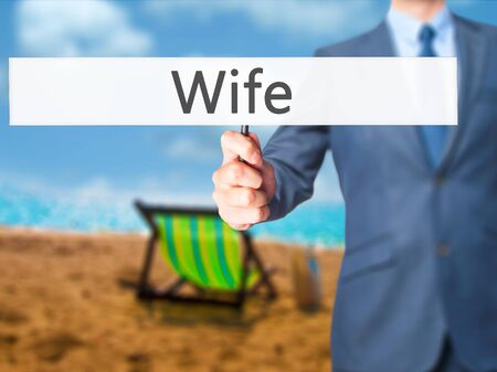 Wife - Businessman hand holding sign. Business, technology, internet concept. Stock Photo Stock Photo