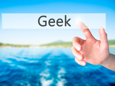 Geek - Hand pressing a button on blurred background concept . Business, technology, internet concept. Stock Photo