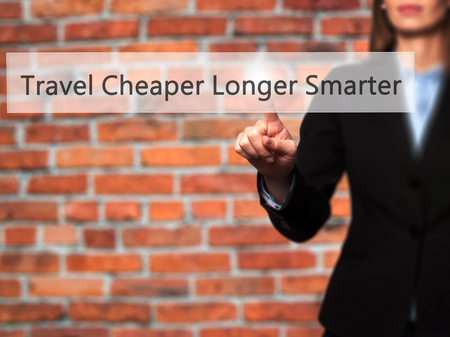 smarter: Travel Cheaper Longer Smarter - Businesswoman pressing high tech  modern button on a virtual background. Business, technology, internet concept. Stock Photo