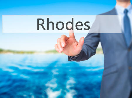 Rhodes - Businessman hand touch  button on virtual  screen interface. Business, technology concept. Stock Photo Stock Photo