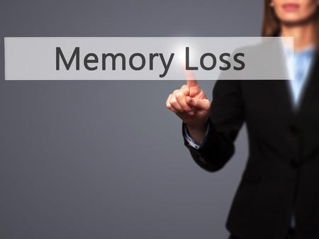 senile: Memory Loss - Businesswoman pressing high tech  modern button on a virtual background. Business, technology, internet concept. Stock Photo