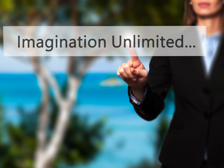 unlimited: Imagination Unlimited... - Businesswoman pressing high tech  modern button on a virtual background. Business, technology, internet concept. Stock Photo