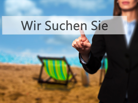 Wir Suchen Sie! (Looking For You in German) - Businesswoman pressing high tech  modern button on a virtual background. Business, technology, internet concept. Stock Photo